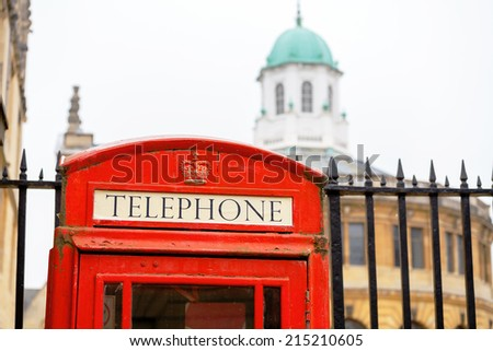 Red telephone box outside Bodleian library. Oxford, England, UK - stock photo