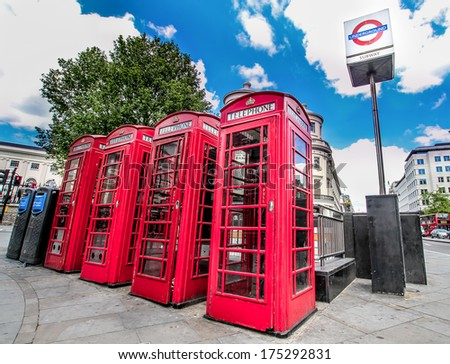 Red Telephone Boxes and Tube Sign  - stock photo