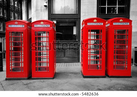 Red telephone boxes on black and white - stock photo