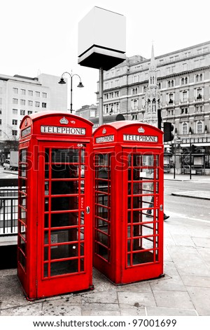 Red telephone boxes with black and white background, London, UK. - stock photo