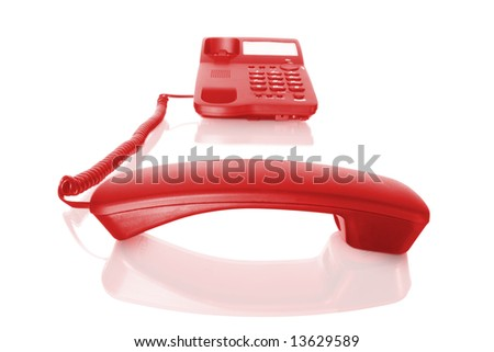 red telephone with receiver off. isolated on white with reflection