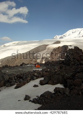 red tent among glaciers - stock photo
