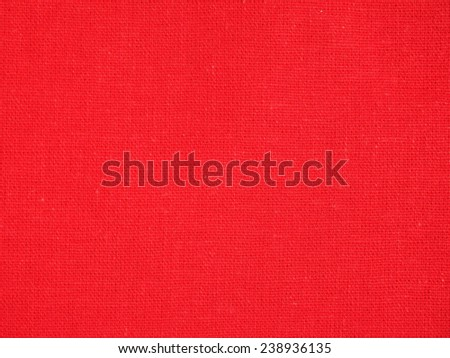 Red textile fabric texture useful as a background