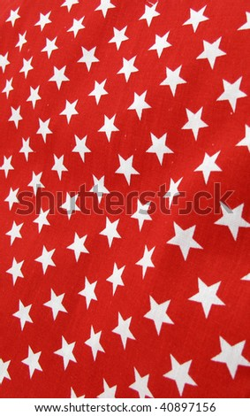 Red textile pattern with white stars