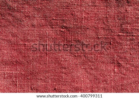 red textile texture. Background and texture for design. - stock photo