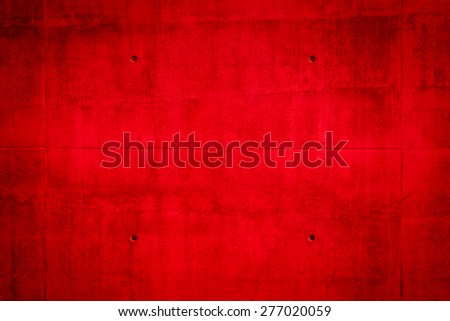 Red texture background with bright center spotlight - stock photo