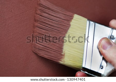 Red Textured Paint Applied With Brush - stock photo