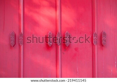 Red Thai traditional door - stock photo