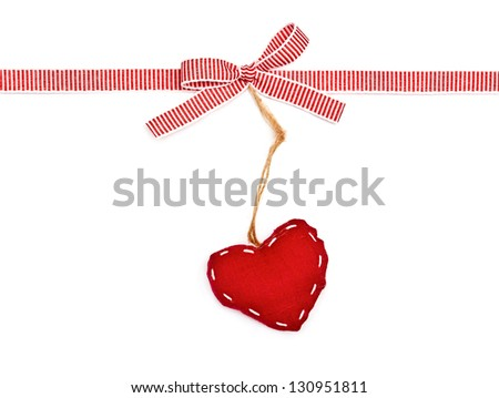 red the white ribbon in a strip, a bow and the heart, isolated on white background - stock photo