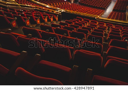 red theater chairs - stock photo