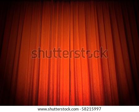 Red theater curtain under spotlight. - stock photo