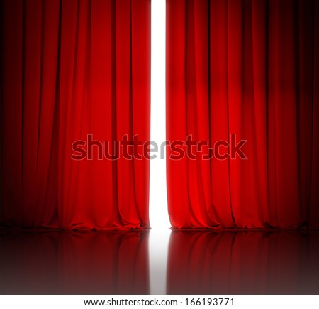 red theater or cinema curtain slightly open and white light behind it - stock photo