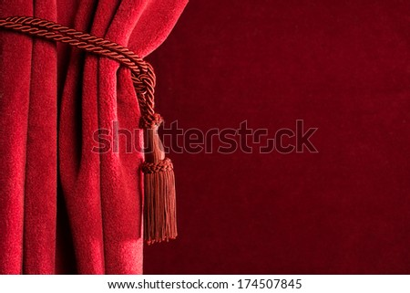 Red theatre curtain and red tassels - stock photo