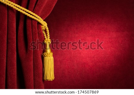 Red theatre curtain and yellow tassels - stock photo