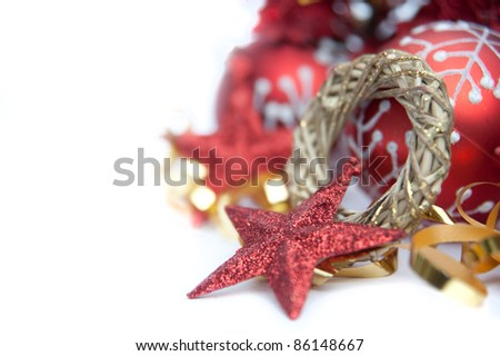 Red theme Christmas decorations against white background