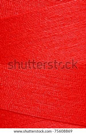 Red thread on spool - stock photo