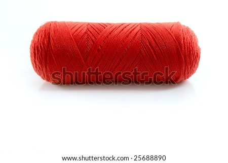 Red thread spool isolated over white studio background - stock photo