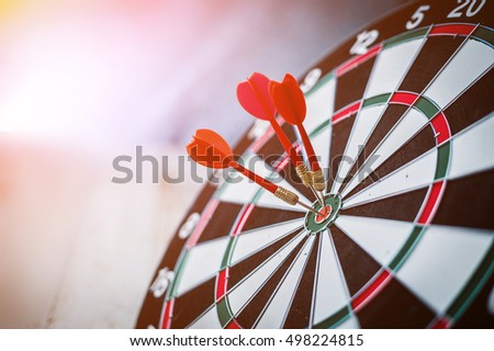 red three darts arrows in the target center business goal concept
