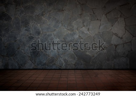 Red tile floors and stone wall. - stock photo