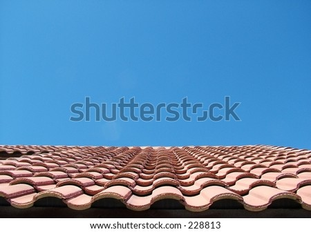 Red Tile Roof Against Bright Blue Sky