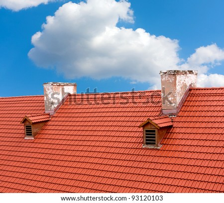 Red tile roof of old house - stock photo