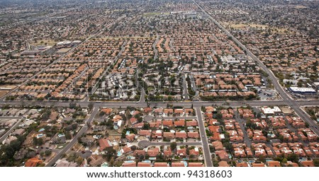 Red Tile Roofs dominate the landscape in the suburbs of Scottsdale, Arizona - stock photo