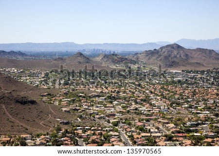 Red Tile Rooftops and the Phoenix, Arizona Skyline - stock photo