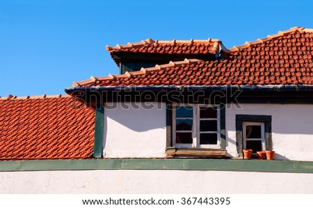 Red tiled roofs with windows in the old town. Porto, Portugal - stock photo