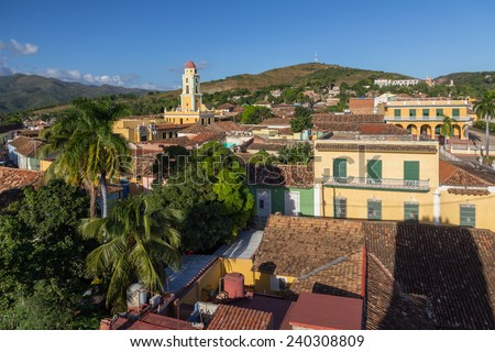 Red-tiled rooftops and iconic Bell-tower of UNESCO-preserved Trinidad, Cuba set against the Loma de la Vigia hill.  - stock photo