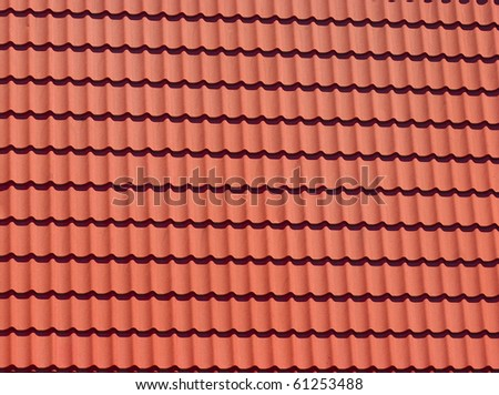 Red tiles of modern rooftop