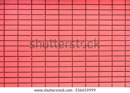 Red tiles on the wall, parallel lines and rectangles background.