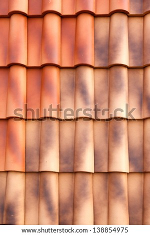 Red tiles roof background closeup - stock photo