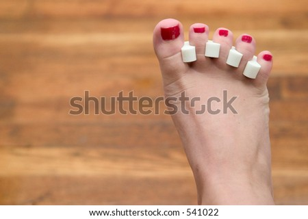 red toenails freshly painted - stock photo