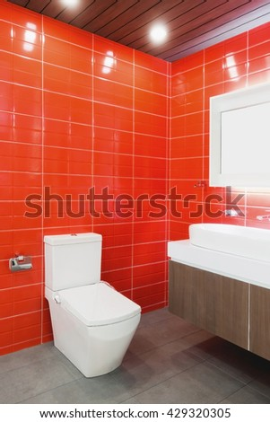 red toilet with red tile and white sanitary