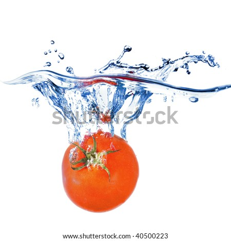 red tomato dropped into blue water isolated on white - stock photo