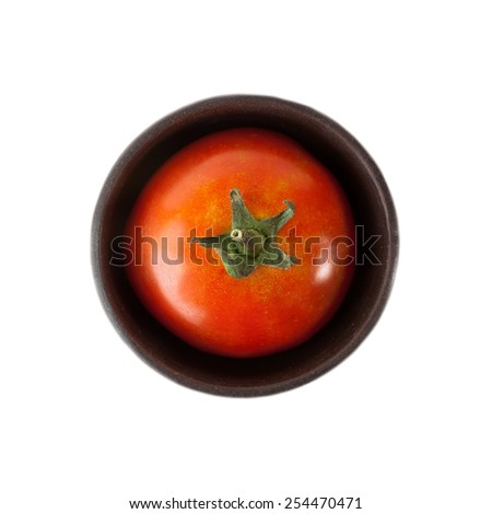 Red Tomato in a clay cup isolated on white background - stock photo