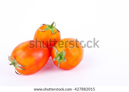 Red tomato is a vegetable that is a major component in making tomato sauce on the white background isolated