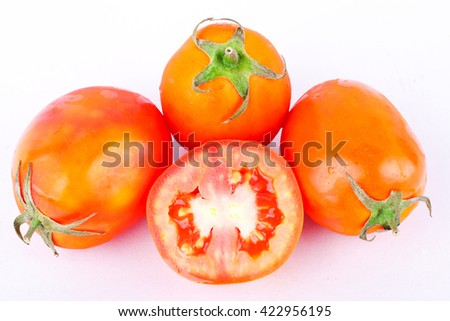 Red tomato is a vegetable, that is healthy and has a high nutritional value on the white background isolated