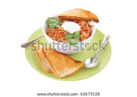 red tomato soup with toasts on green plate - stock photo