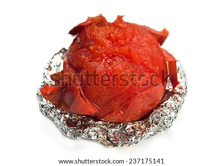 Red tomato vegetable fried in foil isolated on white