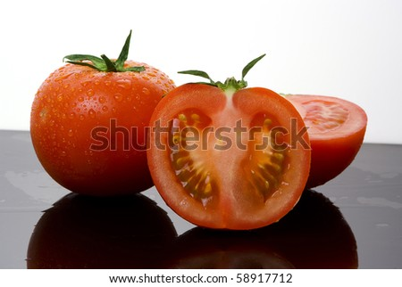 red tomato vegetable with cut - stock photo