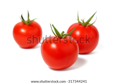Red tomatoes isolated on white - stock photo