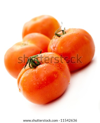 red tomatoes isolated over a white background
