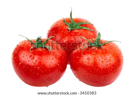 Red tomatoes. Isolated over white background
