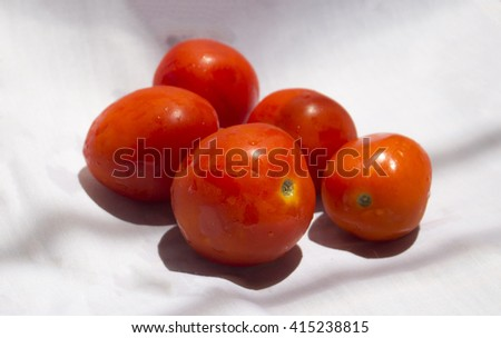 Red tomatoes on white background, Fresh red tomato closeup. Bunch of tomatoes photoshot. Fresh vegetable tomato. Tomato soup cooking. Raw food for vegetarians, tomato salad cook. Round tomato   - stock photo