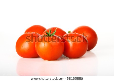 red tomatoes - studio shot - stock photo