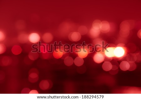 Red tone blur bokeh light. Defocused  background. - stock photo