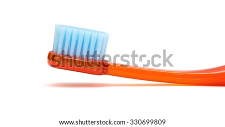 Red toothbrush isolated on a white background - stock photo