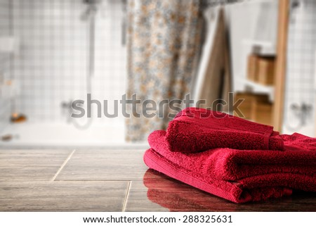 red towels in bathroom and free space  - stock photo