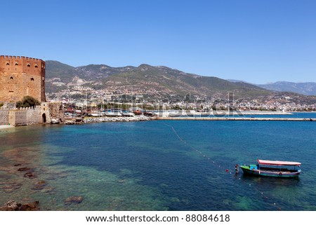 Red tower and harbor. Beautiful view of city Alanya in Turkey - stock photo